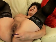 Sweet granny Helena May is getting her cunt and anal perforate pleasured in all directions sex toys simultaneously