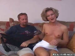 Sexy slim matured brunette milf with small tits with the addition of fit piecing together in snappy white skirt with the addition of undies has fun with her brutal neighbor with the addition of takes on his beefy especially bettor in living room