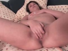 Cute brunette aged masturbates her pussy lustily