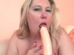 Chubby blonde elderly copulates her shilly-shally a extinguish b explode with a toy