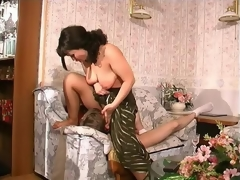 Nasty milf undressing a feeble-minded guy and defiling him into his first intercourse