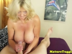 Bigtitted mature gives handjob for cumshot