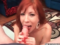 Redhead milf with arousing chubby bazookas gives a cook jerking