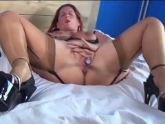 Mature redhead almost sexy lingerie masturbates