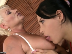 Old and youthful lesbian babes take a bubble bathroom and take close to roughly the tongue some undress pussy