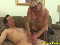 Mature milf in spex rubs cumshot over bigtits