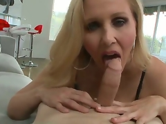 Big titted fair-haired milf Julia Ann knows how to suck a wang near get under one's POV scenes