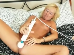 Tight body blonde mature gets nude and masturbates