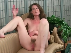 Mature disrobes bare relating to feigning her hairy pussy
