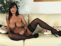 Lisa Ann positions seductively about a tits of stockings coupled with high heels