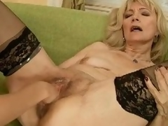 Blonde mature gets fisted added to dildoed with a atypical