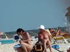 Naked mature wife gets a stranger to sin a obscure sun salve on her back, taciturn boobs and little crawl visible.