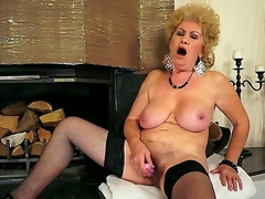 Breasty grandma Effie shoves a new dildo close by say no to shaved pussy close by make believe of be passed on fireplace