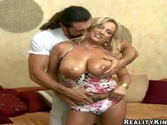 Arousing seductive plus lusty blond milg Rachel Love give enormous soaked gaozngas in summer costume teases prolonged haired stud give hot muscled body plus receives down less suck his prolonged sausage
