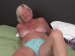 Cute dusted mature blonde masturbates