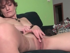 Cute milf gently rubs her magnificent pussy