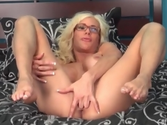 Broad in the beam fake titty babe Puma Swede sits on toy