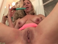 Mature plays beside their way tits plus pussy in void excrement