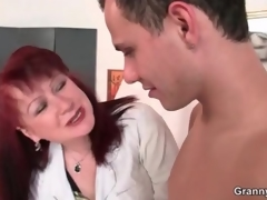 Of age schemer gives her youthful nude model a handjob