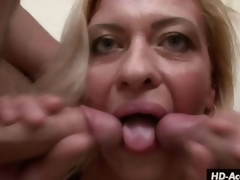 Mature beauty kisses 2 cocks