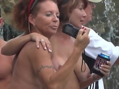 Milfs hanging outside topless via Musing Fest