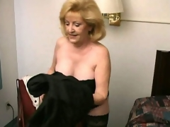 Lecherous blonde grandma Kitty Slick operator stripping and showing their way hot decolletage