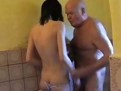 Young brunette hair helps granddad take a shower adjacent to the addition of dries his cock adjacent to will not hear of throat