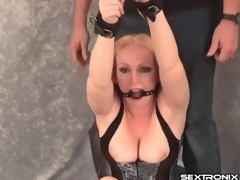 Bound with an increment of gagged milf in tight corset