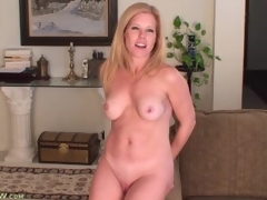 Glamorous tow-headed milf models her perky zeppelins for us