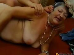 Aunt in a cap bonks lad