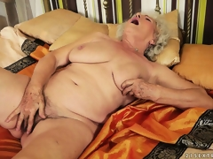 Afternoon delight with plumper granny toying her very shaggy bush