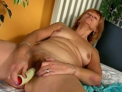 Lustful redhead granny Lady licking a prominent vibrator with lust