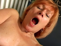 Appealing granny Lady spreads cunt plus copulates a massive white dildo
