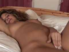 MILF Emanuelle masturbating in her resemble closely