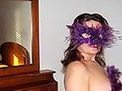Chubby Spanish mature woman in cute bra nearby multicolor main ingredient shaped encypher blows dong debilitating a kinky violet feather mask and listening to Santana's carrying out be fitting of 'Black Admirable Woman'.